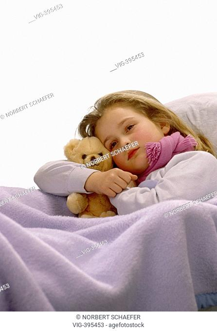 A little girl lying ill in her bed with her teddy. - 14/02/2007