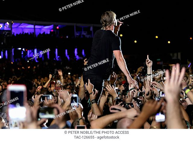 Singer Dan Reynolds of Imagine Dragons performs in the crowd at Life is Beautiful Music Festival Day 2 on September 26th, 2015 in Las Vegas, Nevada