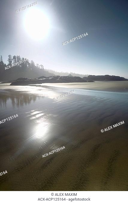 Pacific Rim National Park Reserve, Long Beach, surreal sunrise scenery of the sandy ocean shore during low tide in bright summer sunshine