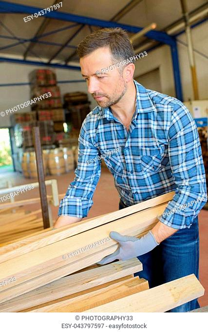 sawmill employee working with wood tools and machinery