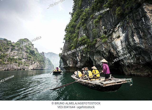 A tourists boats in the karst landscape of Ha Long Bay, Quang Ninh Province, Vietnam. Ha Long Bay is a UNESCO World Heritage Site