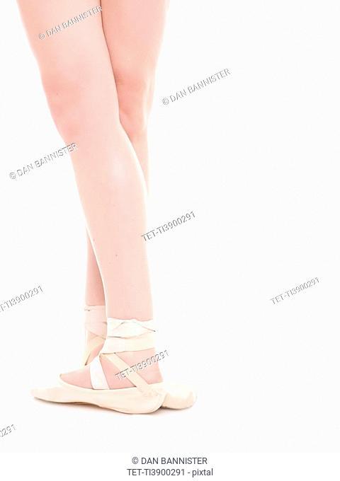 Ballet dancer's legs, studio shot