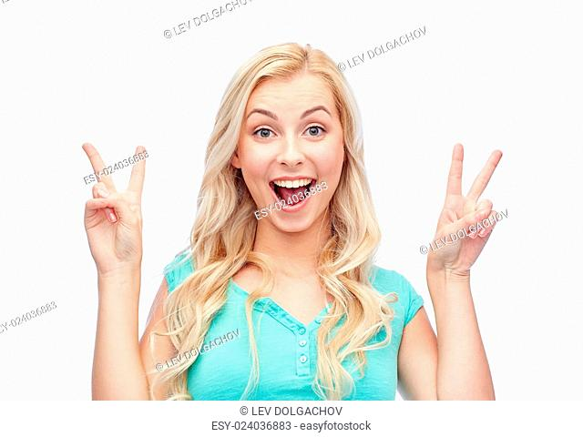 positive gesture and people concept - smiling young woman or teenage girl showing peace hand sign with both hands