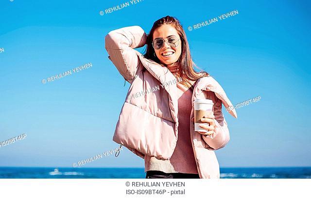 Stylish mid adult woman on beach against blue sky, portrait, Odessa, Odeska Oblast, Ukraine