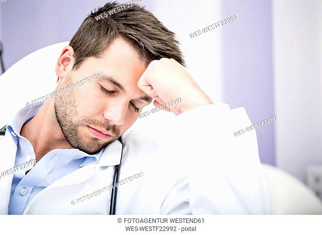 Portrait of exhausted doctor