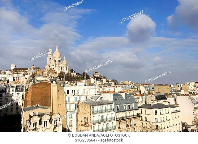 """Paris, France - """"""""Miracle"""""""" like round cloud formed close to Sacre-Coeur Basilica in Montmartre"""