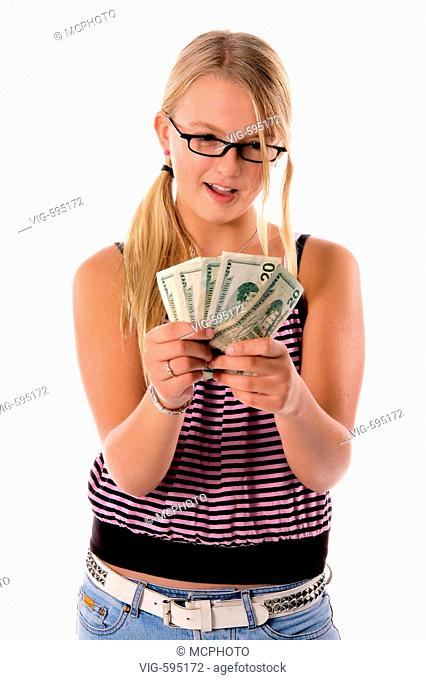 Young girl in cute cloths with a handful of cold hard cash ready to do some Back To School Shopping  - 18/12/2007