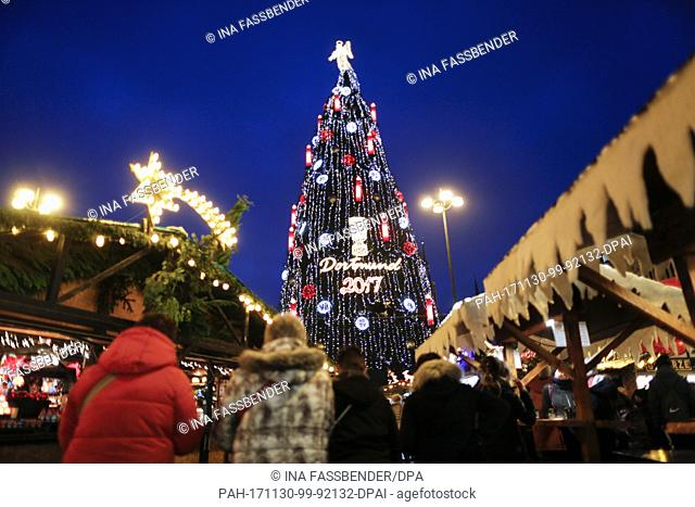 dpatop - The according to the organisers biggest Christmas tree in the world illuminates the Christmas market in Dortmund, Germany, 30 November 2017