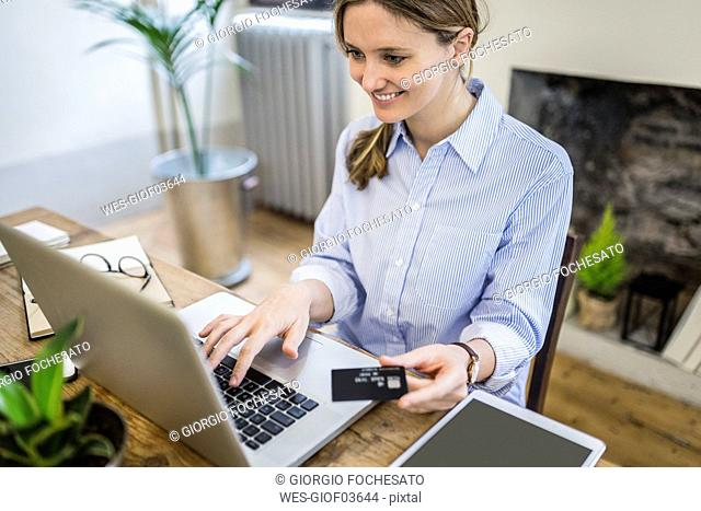 Happy woman at home shopping online
