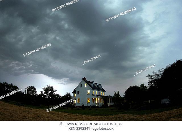 Rain storm over farm house, Maryland