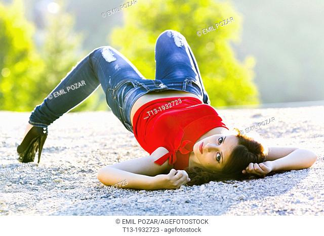Awkward lying on ground young woman