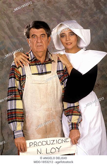 Italian director Nanni Loy directing Italian showgirl Mara Venier (Mara Provoleri) on the set of the TV show Candid Camera. Italy, 1988