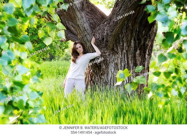 A young woman outdoors in the summer in Spokane, Washington, USA