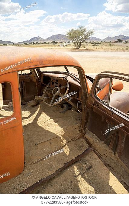 Old rusted car in the Namib desert, Sossusvlei, Namibia