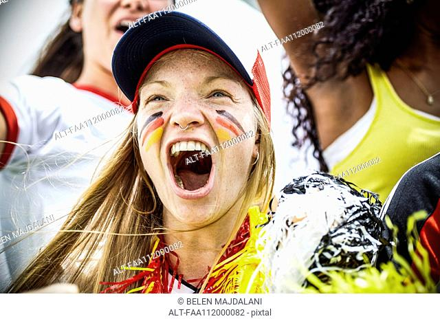 German football fan cheering at match