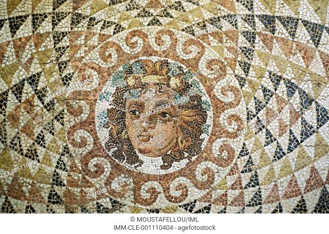 Mosaic floor decorated with the head of Dionysos framed by ornaments  Ancient Corinth, Peloponnese, Greece