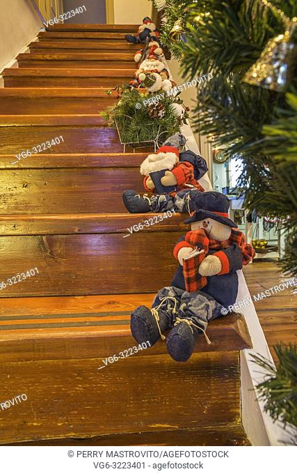 Old wooden staircase with Christmas decorations inside an old circa 1886 Canadiana cottage style home