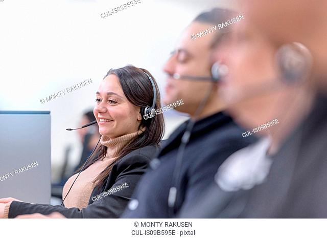 Operators in automotive call centre in car factory