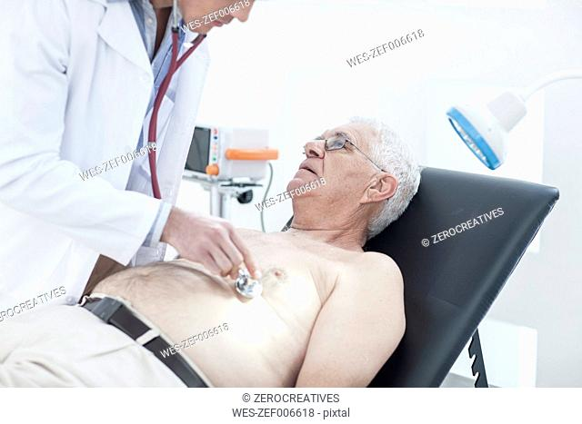 Doctor ausculating patient