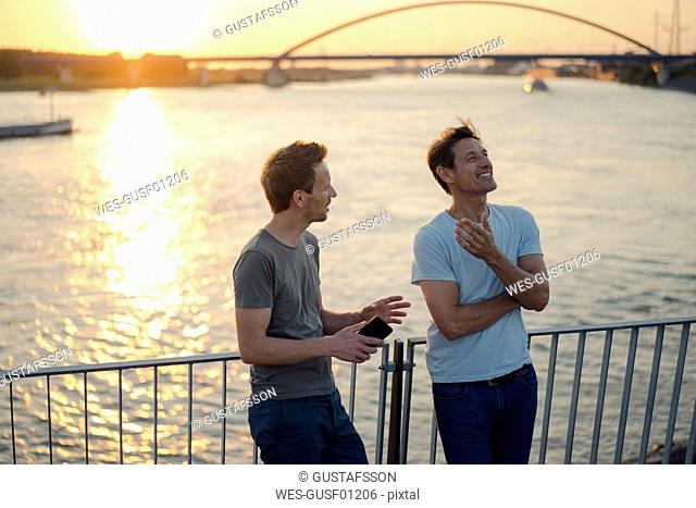 Two friends meeting at sunset, spending the evening talking