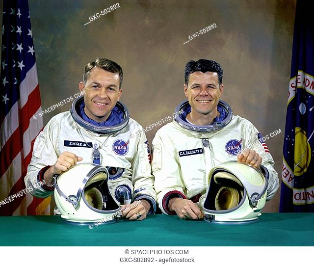 The original Gemini 9 prime crew, astronauts Elliot M. See Jr. left, command pilot, and Charles A. Bassett II, pilot, in space suits with their helmets on the...