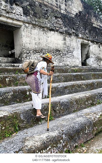 Guatemala, Tikal, Shaman walking down temple steps