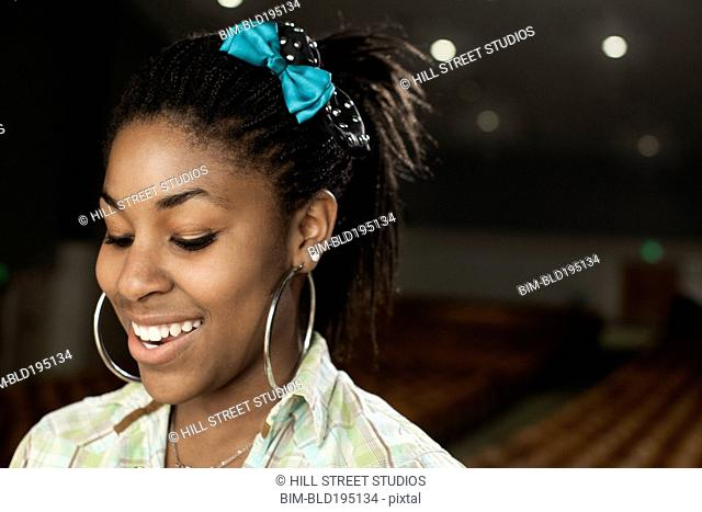 Black teenage girl rehearsing on stage