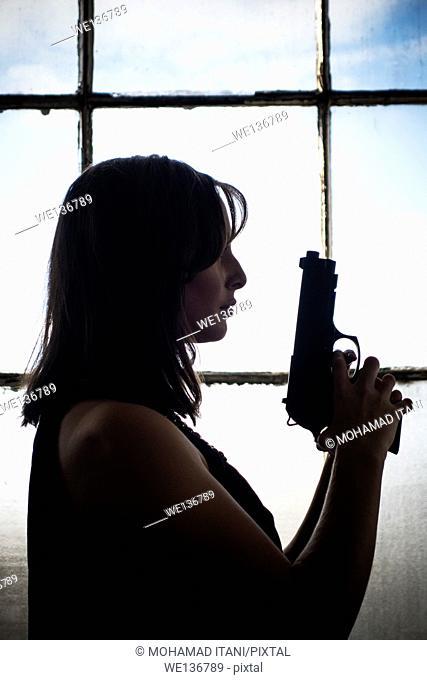 Woman holding a gun