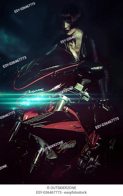 Sunset street, Sensual brunette woman in modern motorcycle design and aggressive