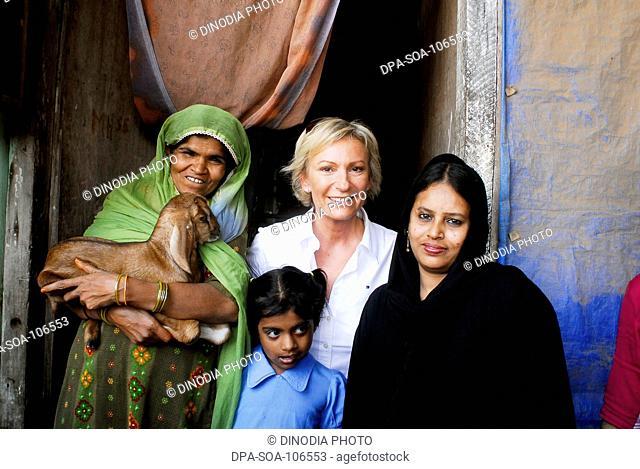 Sabine Christiansen smiling and enjoying at Amrae an NGO at Nehru Nagar ; Golibar Slum ;Santacruz ;Bombay Mumbai ; Maharashtra ; India NO MR