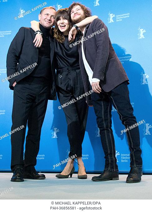 Director Malgoksa Szumowska of Poland (c) and actors Mateusz Kosciukiewicz (r) and Andrzej Chyra (l) pose at a photocall for «In the name of» (W imie) during...