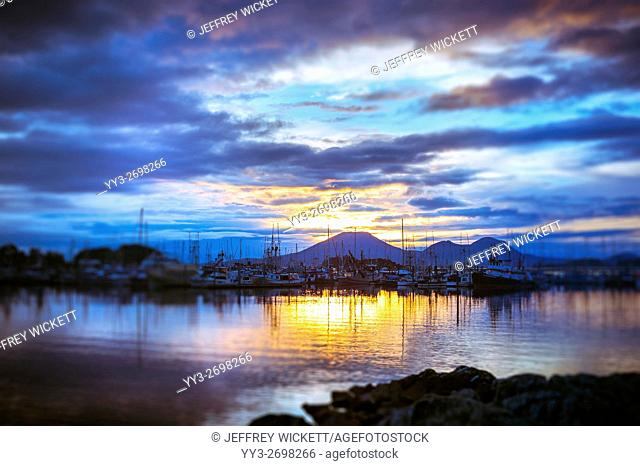Sun setting behind Mount Edgecumbe near Sitka, Alaska, USA