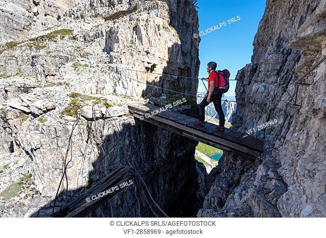 "Sesto/Sexten, Dolomites, South Tyrol, province of Bolzano, Italy. Climber on the via ferrata """"Path of Peace"""" to the mountain of Monte Paterno"