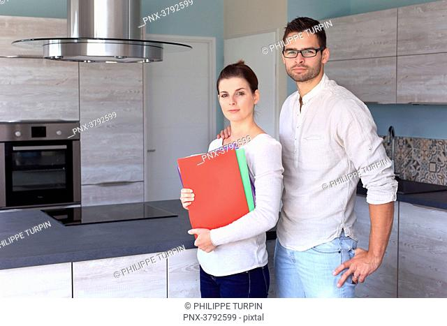 France, young couple in their new house