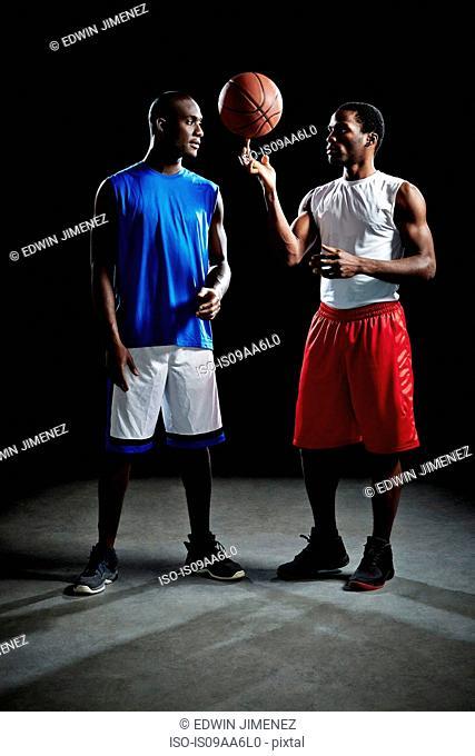 Studio shot of two basketball players