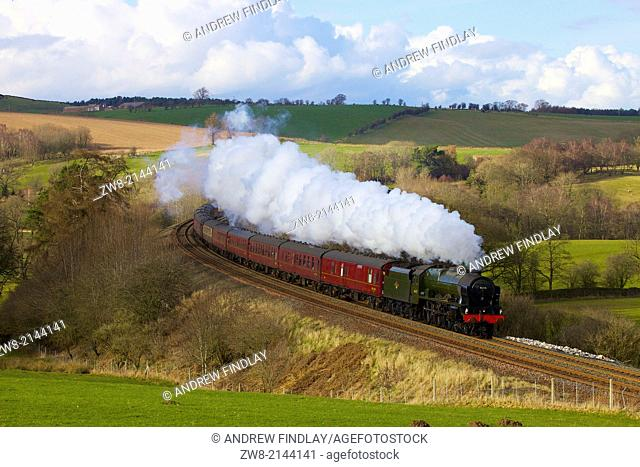 Steam train 46115 Scots Guardsman on the Settle to Carlisle Railway Line near Low Baron Wood Farm Armathwaite Eden Valley Cumbria England United Kingdom Great...