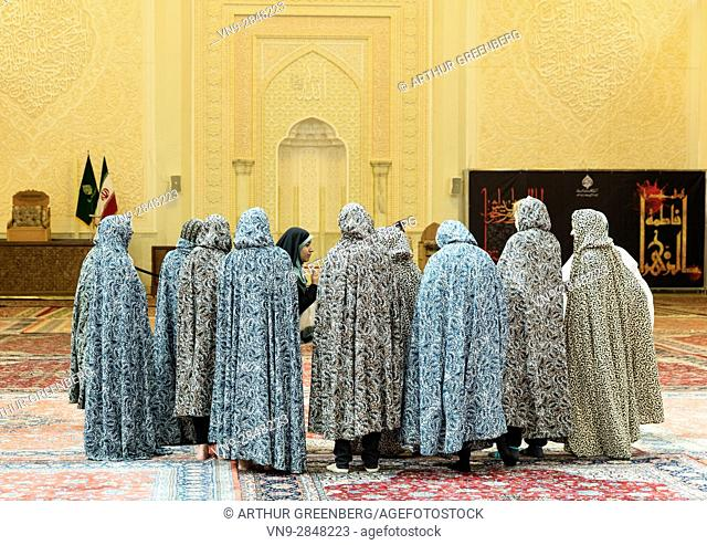 Shiraz, Iran - 23 February 2016: Separated from men, Western women in special chadors visit the interior of the Shah Cheragh mausoleum