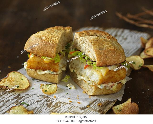 A sandwich with fish in panko breadcrumbs