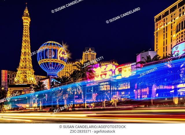Las Vegas Strip Light Show - Light streaks from vehicular traffic in the Las Vegas Strip in Nevada along with the illuminated Paris Las Vegas Hotel and Casino's...