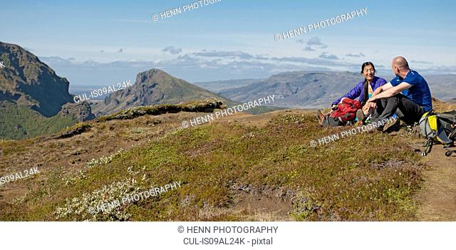Couple taking break on way up to Fimmvordurhals Pass above Thorsmork Valley, Thorsmork, South Iceland, Iceland