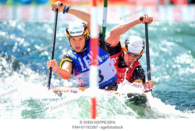 Franz Anton (FRONT) and Jan Benzien of Germany paddle down the ice canal during the canoe double C2 at the men's Canoe slalom World Cup final in Augsburg