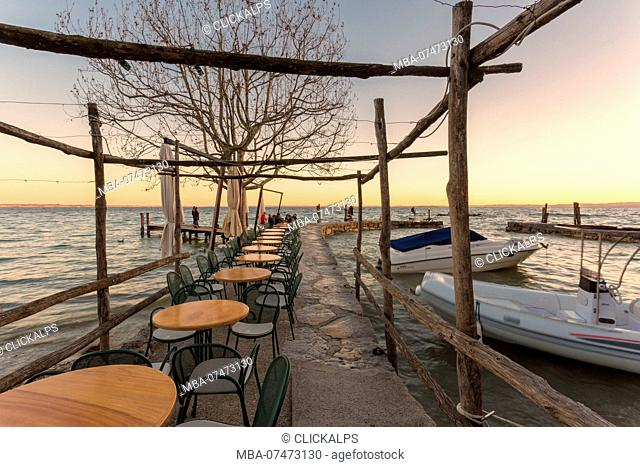 The lakefront restaurant of Punta San Vigilio on the eastern shore of Lake Garda, Verona province, Veneto, Italy