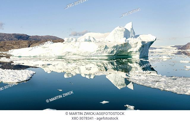 Icebergs in the Uummannaq fjord system in the north of west greenland. Glacier Lille Gletscher and the ice cap in the background