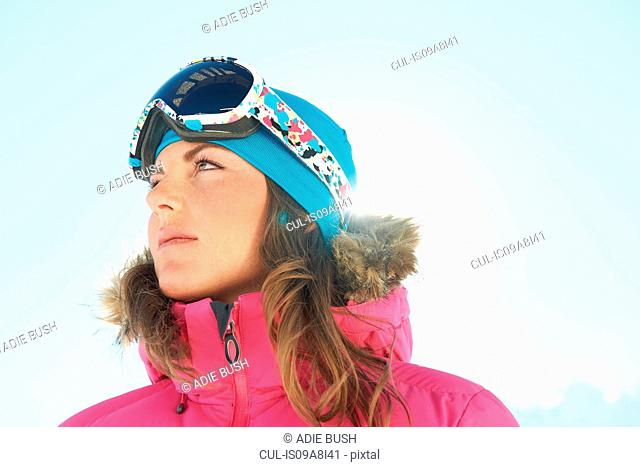 Portrait of a young female skier