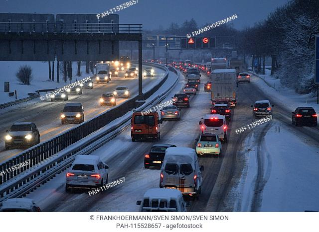 Snow chaos on the streets of Bavaria - as here on the A94 motorway in Muenchen Riem is the busy traffic, commuters in the morning on snow-slick streets