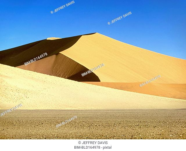 Sand dunes under blue sky in Namib-Naukluft National Park, Namib Desert, Namibia