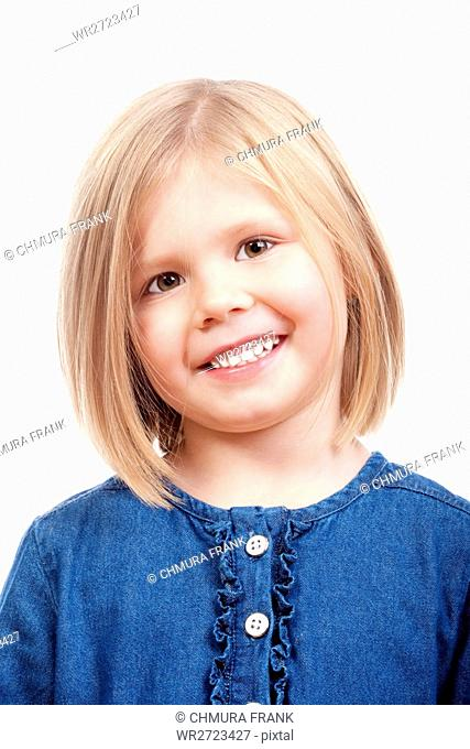 portrait of a happy little girl with blond hair smiling - isolated on white