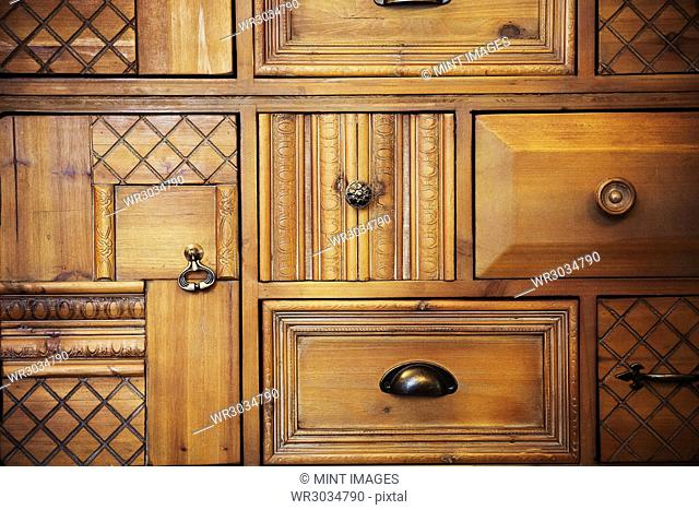 Wooden panels showing different wood finishes, carving, criss cross grooves, marks and handles