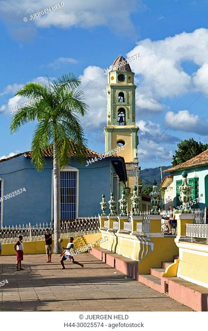 Bell tower of Iglesia y Convento de San Francisco, Plaza Mayor, kids playing soccer, Trinidad Cuba