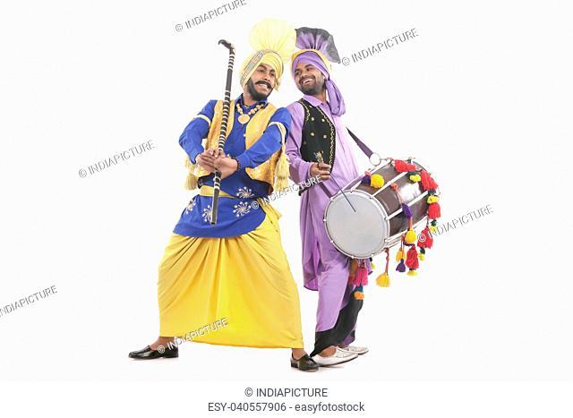 Sikh men doing bhangra dance